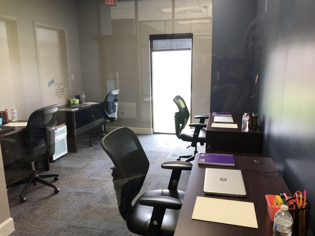 Desks in FX Logistics office ready for students on Monday
